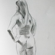 Standing female nude from behind